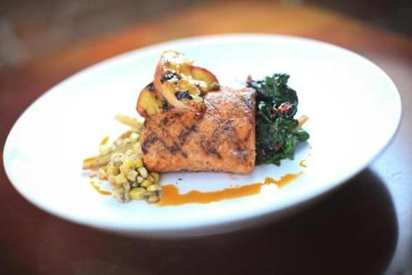 Wild salmon with corn-and-farro ragout and Swiss chard at Ceia Kitchen + Bar.